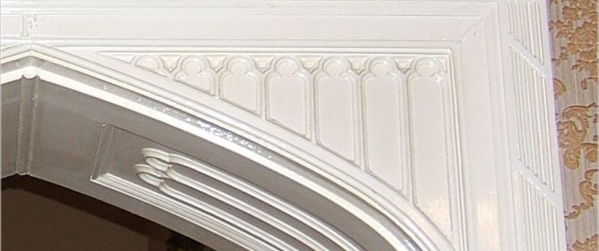 Detail of spandrel at the top of the door frame into drawing room.